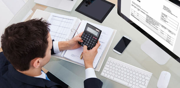 Man Doing Taxes with a Calculator