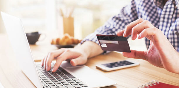 Man on the computer with a credit card