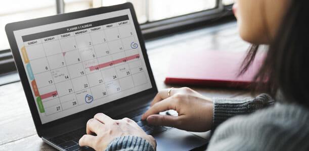 Woman Using Computer Calendar